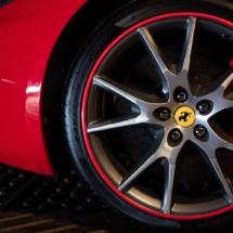 Close Up Of A Silver Ferrari Alloy Wheel, With Red AlloyGator Wheel Rim Protector And Red Break Calliper