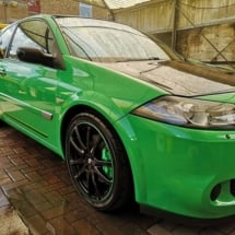 Side View Of Green Nissan Skyline With Green AlloyGators