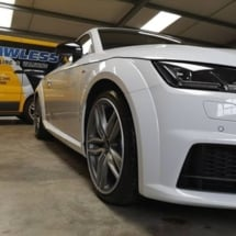 Side View Of White Audi With White AlloyGators