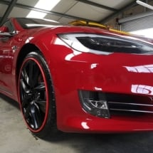Side View Of Red Tesla With Red AlloyGators