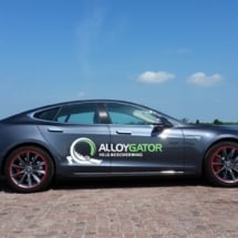 Side View Of Grey Tesla Model S Silver Alloy Wheel With Red AlloyGator Wheel Protector & Red Callipers