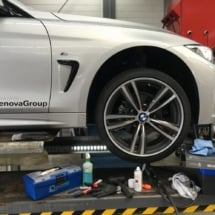 Front Side View Of Silver BMW With Silver Alloy Wheel And White AlloyGator Wheel Protector