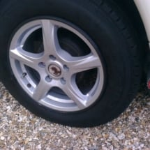 Close Up View Of Caravan With Silver Alloy Wheels And Black AlloyGator Wheel Protection