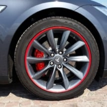 Close Up View Of Grey Tesla Model S Silver Alloy Wheel With Red AlloyGator Wheel Protector & Red Callipers