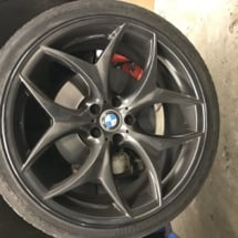 Close Up Of Black AlloyGator Wheel Protector On Black BMW Alloy Wheel