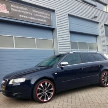 Side View Of Blue Audi With Silver Alloy Wheels And Red AlloyGator Wheel Protection