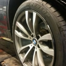 Side View Of Silver BMW Alloy Wheel With Black AlloyGator Wheel Protector