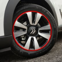 Close up of Citroen alloy wheel with a Red AlloyGator wheel protector