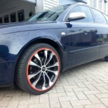 Side View Of Blue Audi With Silver Alloy Wheels And Orange AlloyGator Wheel Protection