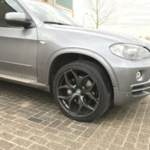 Close up of silver BMW with black alloy wheels and black AlloyGator wheel protectors