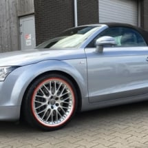 Side View Of Audi With Silver Alloy Wheels & Red AlloyGator Wheel Protectors