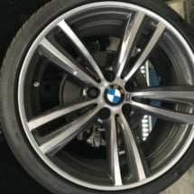 Close Up Silver BMW Alloy Wheel With Silver AlloyGator Wheel Protector