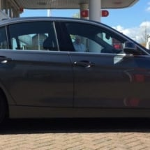 Side View Of Black BMW With Silver Alloy Wheels And Black AlloyGator Wheel Protection