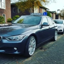 Side View Of BMW With Silver Alloy Wheels And White AlloyGator Wheel Protectors