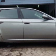 Side View Of Alfa Romeo With Silver Alloy Wheels And Red AlloyGator Rim Protectors