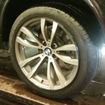Close Up View Of Silver BMW Alloy Wheel With Black AlloyGator Wheel Protector