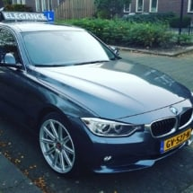 Black BMW With SilverAlloy Wheels And Black AlloyGator Wheel Protector