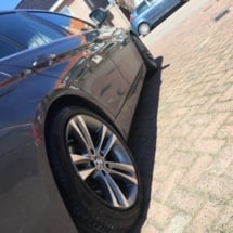 Close Up View Of Black BMW With Silver Alloy Wheels And Black AlloyGator Wheel Protection