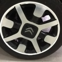 Close up of Citroen C3 alloy wheel with a white AlloyGator wheel protector