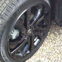 Close Up Of Black Land Rover Alloy Wheels With Black AlloyGator Wheel Protection On Gravel