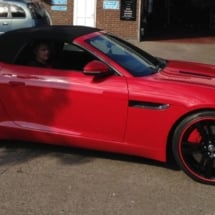 Red Jaguar With Black Alloy Wheels, Red AlloyGator Wheel Protectors And Red Brake Caliper