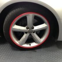 Close Up Of White Audi Alloy Wheel With Red AlloyGator Wheel Protector