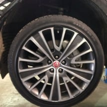 Close Up Of Jaguar Silver & Black Alloy Wheel With Black AlloyGator Wheel Protection