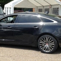 Black Jaguar With Silver & Black Alloy Wheels And Black AlloyGator Wheel Protection In A Car Park