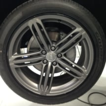 Close Up View Of A Grey Audi Alloy Wheel With Black AlloyGator Wheel Protection