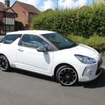 Side View Of A White Citroen With Dimond Cut Silver And Black Alloy Wheels And White AlloyGator Alloy Protector