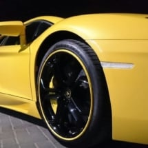Close Up Of A Yellow Lamborghini With Black Alloy Wheels And Yellow AlloyGator Alloy Wheel Protectors