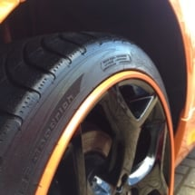 Close Up Of An Orange Fords Black Alloy Wheels With Orange AlloyGator Alloy Wheel Protector