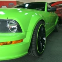 Front View Of Green Ford GT With Original Green AlloyGator Alloy Wheel Rim Protectors