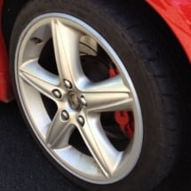Close Up Of Holden Silver Alloy Wheel With Silver AlloyGator Wheel Protector And Red Brake Calliper