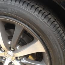 Close Up Of Honda Silver Alloy Wheel With Black AlloyGator Wheel Protector