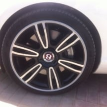 Close Up View Of White Bentley With Silver Alloy Wheels With Silver AlloyGator Wheel Protector