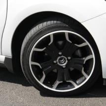 Front Of A White Citroen With Dimond Cut Silver And Black Alloy Wheels And White AlloyGator Alloy Wheel Protector
