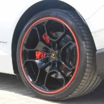 Close Up View Of A White Lamborghini With Black Alloy Wheels And Red AlloyGator Alloy Wheel Protectors