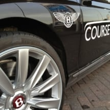 Close Up Side View Of Black Bentley With Silver Alloy Wheels With Silver AlloyGator Wheel Rim Protector