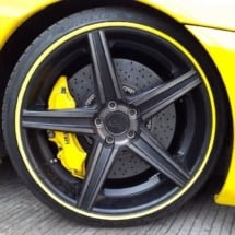 Close Up Of A Yellow Ferrari Front Alloy Wheel With Yellow AlloyGator Wheel Rim Protector And Yellow Break Callipers