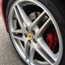 Close Up Of Red Ferrari And Its Silver Alloy Wheel, Red Brake Calliper & Silver AlloyGator Alloy Wheel Protector