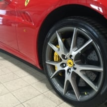 Close Up View Of Front Wheel Of A Red Ferrari With Silver Alloy Wheels, Black AlloyGator Alloy Wheel Rim Protector & Yellow Brake Callipers