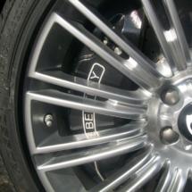 Close Up Of Silver Bentley Alloy Wheel With Black AlloyGator Wheel Rim Protector