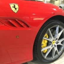Close Up View Of Front Wheel Of A Red Ferrari With Silver Alloy Wheels, Black AlloyGator Alloy Wheel Protector & Yellow Brake Callipers