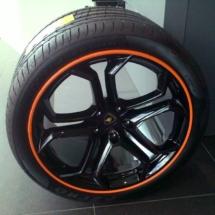 Close Up Of Lamborghini Alloy Wheel With Orange AlloyGator Alloy Wheel Protector