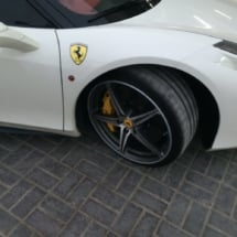 Close Up View Of Front Wheel Of A White Ferrari With Silver Alloy Wheels, Silver AlloyGator Alloy Wheel Protector & Yellow Brake Callipers
