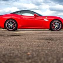 Red Ferrari with alloy wheel rim protectors