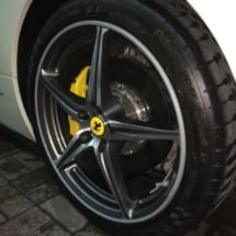 Close Up View Of Front Wheel Of A Silver Ferrari With Silver Alloy Wheels, Silver AlloyGator Alloy Wheel Protector & Yellow Brake Callipers