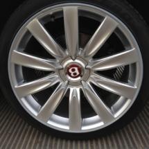 Close Up Of Silver Bentley Alloy Wheel With Silver AlloyGator Wheel Rim Protector