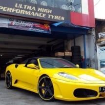 Side View Of A Yellow Ferrari Front Alloy Wheel With Yellow AlloyGator Alloy Wheel Protector And Yellow Brake Callipers